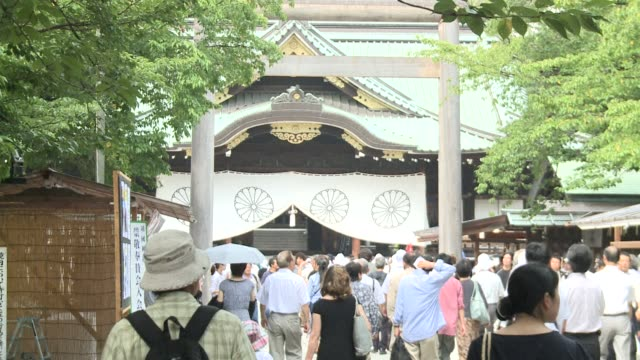 Two Japanese cabinet ministers visit a war shrine on the anniversary of Tokyo's World War II surrender a move set to inflame regional tensions amid...