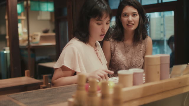 two japanese women ordering food at a restaurant in tokyo, japan - ordering stock videos & royalty-free footage