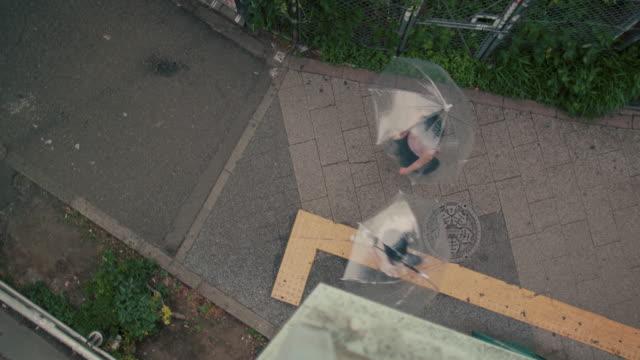 two japanese women walking with umbrellas / tokyo, japan - umbrella stock videos & royalty-free footage