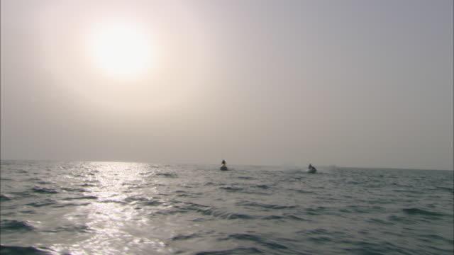 WS, Two jet skiers in sea, Dubai, United Arab Emirates