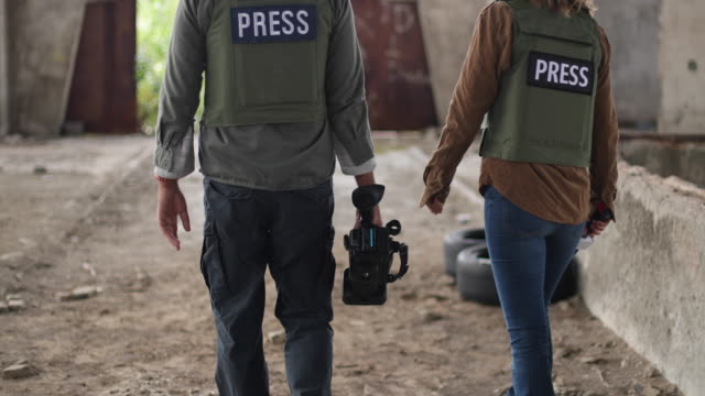 two journalists in the war zone - danger stock videos & royalty-free footage