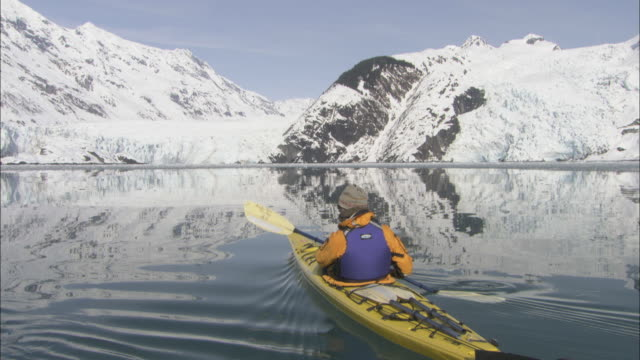 two kayakers paddle in prince william sound, alaska. - prince william stock videos & royalty-free footage