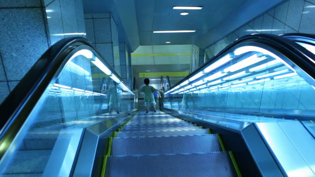 ws two kids playing on escalator / tokyo, japan  - fluorescent light stock videos & royalty-free footage