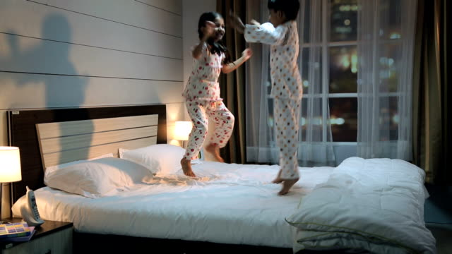 two kids playing on the bed, delhi, india - nightwear stock videos & royalty-free footage