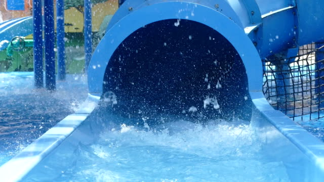 two kids slid from big colorful water slides - water slide stock videos & royalty-free footage