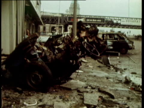 two killed and over 100 injured in car bomb explosion / wrecked cars policeman standing in bombedout street broken windows at liberty hall dublin car... - 1972 stock videos and b-roll footage