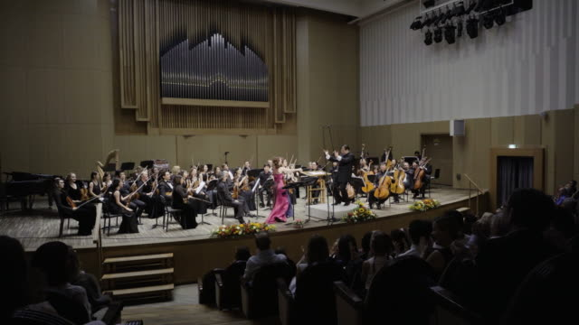 two korean soloist performing classical music and have a prolonged applause. - orchestra stock videos & royalty-free footage