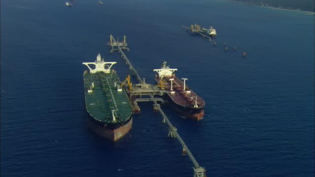 aerial two large tankers docked at off-shore oil terminal, freeport, bahamas - ankrad bildbanksvideor och videomaterial från bakom kulisserna