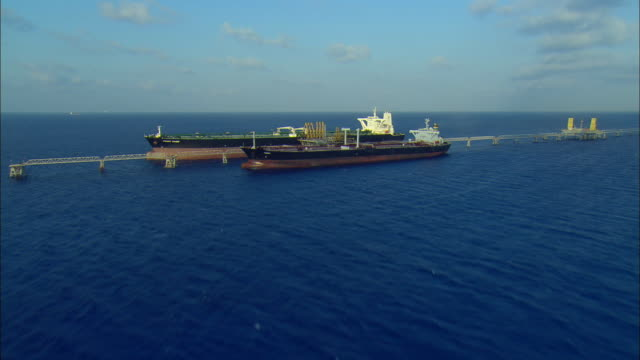 aerial two large tankers offloading at off-shore terminal at freeport, bahamas - anchored stock videos & royalty-free footage