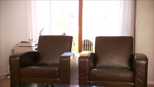 two leather easy chairs furnish a living room. - armchair stock videos & royalty-free footage