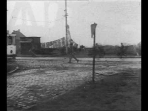 two lines of us troops approach as they walk across duisburg germany drawbridge during world war ii / montage troops walk through duisburg street... - ruhr stock videos & royalty-free footage
