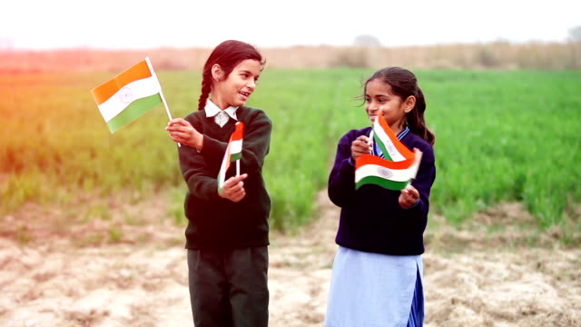 two little girl waving indian flag in the nature - indian flag stock videos & royalty-free footage