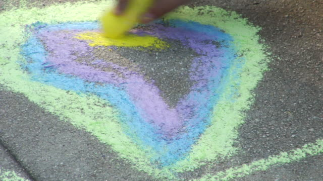 ms zo two little girls drawing flowers on playground / los angeles, california, united states     - sidewalk stock videos & royalty-free footage