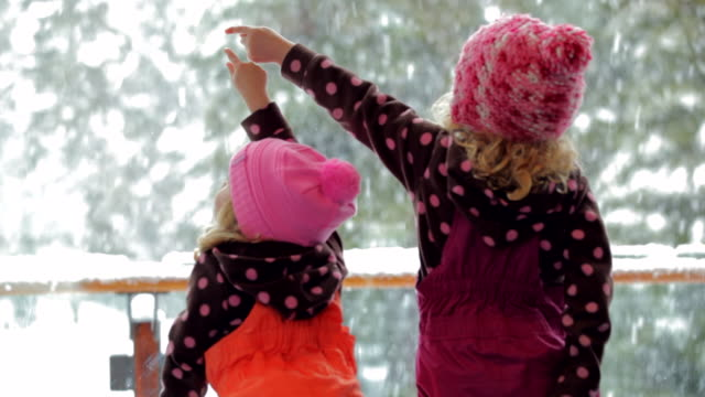 ms two little girls looking out snowy winter day / whistler, bc, canada   - winter video stock e b–roll