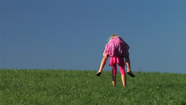 hd: two little girls playing - piggyback stock videos and b-roll footage