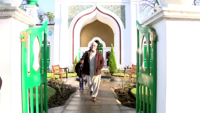 Two London mosques given protected heritage status General view Shah Jahan Mosque interior Muslims praying People along Mohammed Habib setup and...