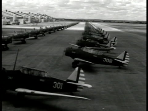two long rows of us fighter airplanes moving forward turing into file position on field. president roosevelt speaking to congress . newspaper on... - 1941 stock-videos und b-roll-filmmaterial