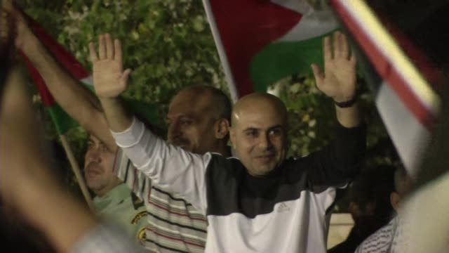 two longterm palestinian prisoners freed by israel as part of usbrokered peace talks arrive in ramallah clean israel frees 26 palestinian prisoners... - prisoner stock videos and b-roll footage