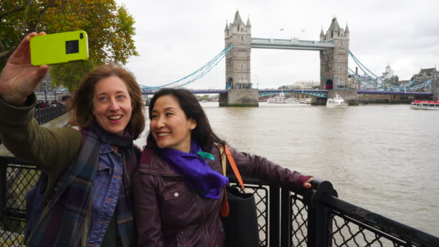 two loverly women having a fun day out in london. - mature couple stock videos & royalty-free footage