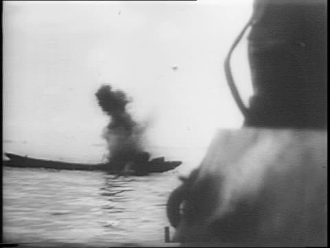 two lvts in water / soldiers on amtrack seen from lvt / japanese landing barge is hit / japanese soldier in water next to wrecked barge / marines... - amfibiefordon bildbanksvideor och videomaterial från bakom kulisserna