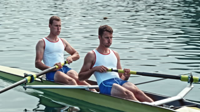 two male athletes sculling across a lake - scull stock videos & royalty-free footage