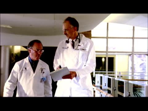 MS, CU, Two male doctors walking through hospital lobby, Swedish American Hospital, Rockford, Illinois, USA