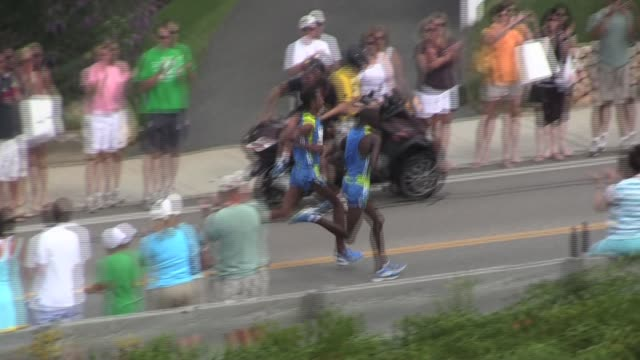 two male elite runners in a close race to finish aerial cape cod two elite runners race to finish aerial cape cod on august 15 2010 - salmini stock videos & royalty-free footage