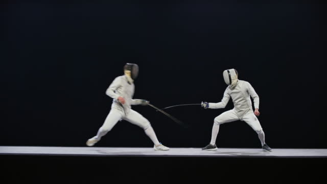 ld two male fencers in a blade action during a bout - rivalry stock videos & royalty-free footage