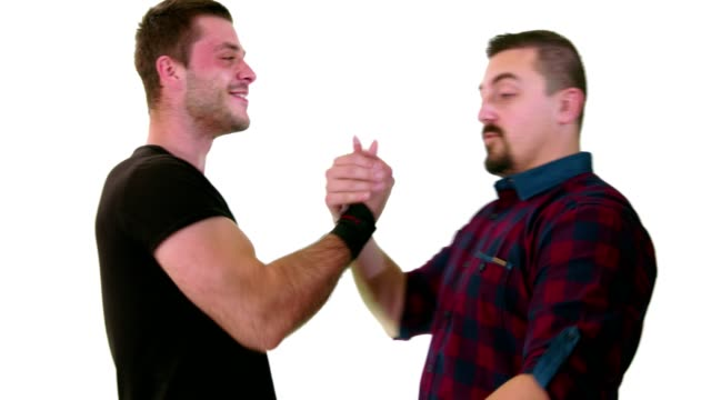 two male friends meet each other and have a pleasant conversation - male friendship stock videos and b-roll footage
