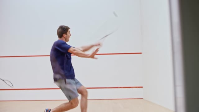 two male friends playing squash - ball stock videos and b-roll footage