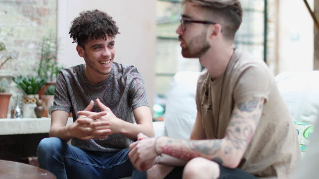 two male friends relaxing at home - tattoo stock videos and b-roll footage