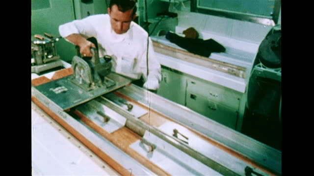 two male geologists in research facility laboratory laying out long core sample slicing labeled sample in half arranging next to each other on table - geologist stock videos & royalty-free footage