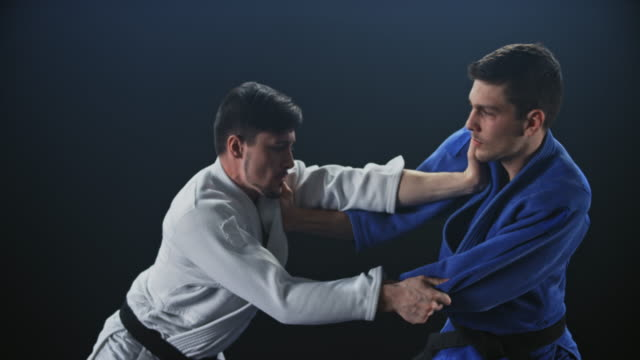 slo mo two male judo opponents in a fight - championships stock videos & royalty-free footage