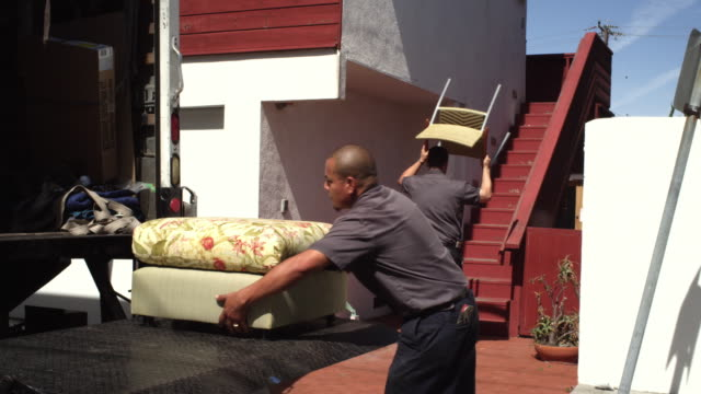 ms  two male movers carring furniture and loading on truck / manhattan beach,california,united states - removal man stock videos & royalty-free footage