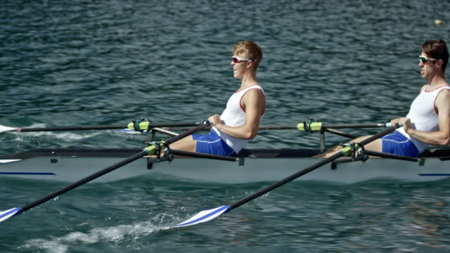 ts two male rowers sculling on a lake - sculling stock videos & royalty-free footage