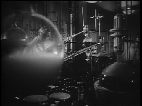 b/w 1952 two male scientists working in laboratory - chemistry stock videos & royalty-free footage