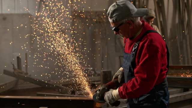 slo mo ds two male workers cutting metal - only mature men stock videos & royalty-free footage