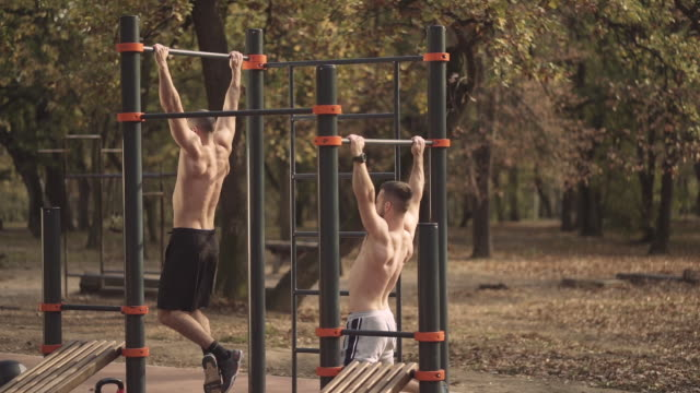 two man doing chin-ups - pull ups stock videos & royalty-free footage