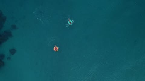 two man relaxing on inflatable rings - floating on water stock videos & royalty-free footage