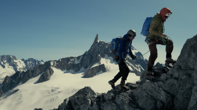 two man rock climbing - mountain climbing stock videos & royalty-free footage