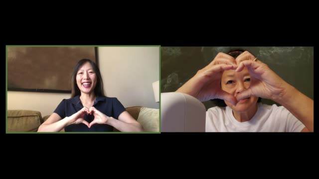two mature asian women make heart hands to each other on a video call - east asian ethnicity stock videos & royalty-free footage