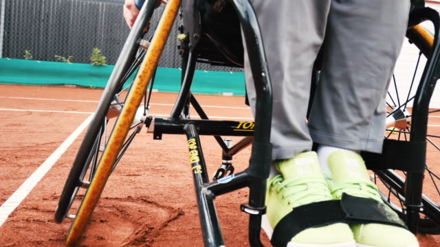 two mature men playing doubles in wheelchair tennis outdoors - 40 44 years stock videos & royalty-free footage