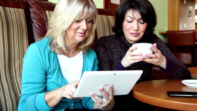 two mature woman digital tablet - eastern european culture stock videos & royalty-free footage