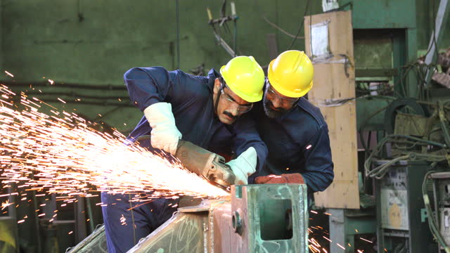 two mechanic using circular saw grinder at factory - grinding stock videos & royalty-free footage