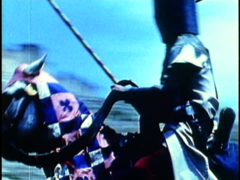 1956 REENACTMENT MONTAGE Two medieval knights on horseback jousting