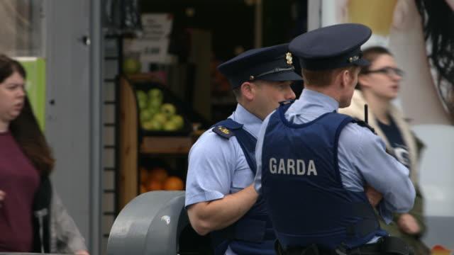 two members of the garda keep watch, dublin, republic of ireland. - dublin republic of ireland stock videos & royalty-free footage