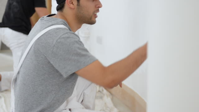 ms tu two men and woman painting wall / london, england, united kingdom - house painter stock videos and b-roll footage
