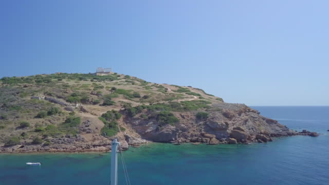 stockvideo's en b-roll-footage met two men and women couples relaxing in hammocks on anchored sailboat aerial drone view near islands in greece. - anchored
