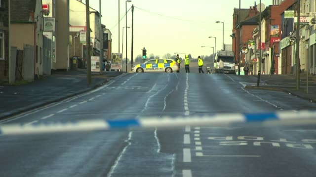 Two men appear in court accused of planning terrorist attack LIB / T19121704 Sheffield EXT Police officers in cordoned off terraced street at scene...