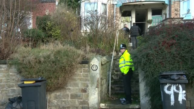 Two men appear in court accused of planning terrorist attack LIB / T19121704 Sheffield EXT Various of Police officers outside house following raid